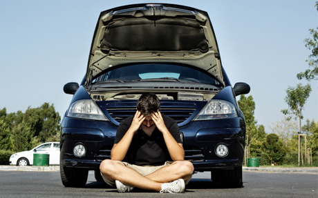 sad man because he put wrong fuel in his car